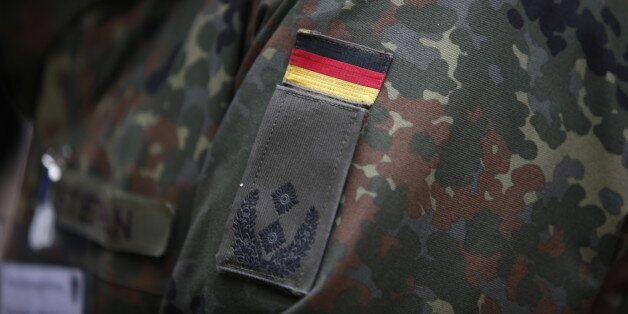 German Bundeswehr army soldiers demonstrate their skills at Kaserne Hochstaufen (mountain infantry military...