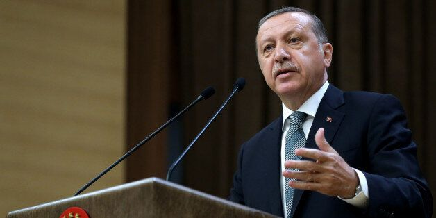 Turkey's President Recep Tayyip Erdogan addresses local administrators at his palace in Ankara, Turkey,...