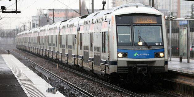 A train arrives at the Val de Fontenay RER railway station in Fontenay-sous-Bois near Paris, France,...