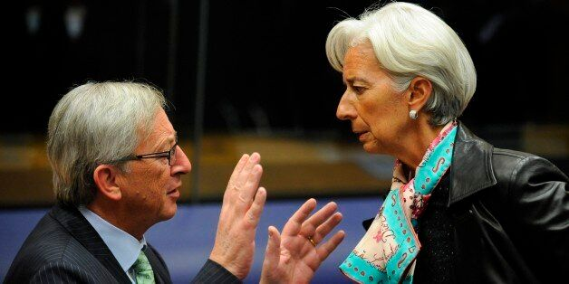 Luxembourg Prime Minister and President of the Eurogroup Council Jean-Claude Juncker (L) speaks with...