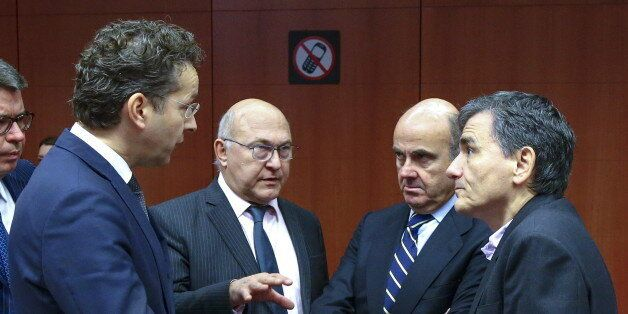 (L-R) Dutch Finance Minister and Eurogroup President Jeroen Dijsselbloem, France's Finance Minister Michel...