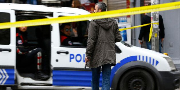 Police secure the area following a suicide bombing in a major shopping and tourist district in central...
