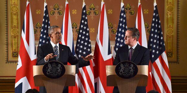 LONDON, ENGLAND - APRIL 22: US President Barack Obama (L) and British Prime Minister David Cameron during...
