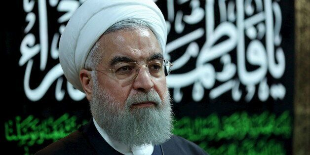 Iranian President Hassan Rouhani attends a ceremony mourning the death of Fatima, daughter of Prophet...