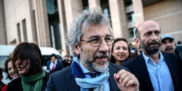 Turkish opposition Cumhuriyet daily's editor-in-chief Can Dundar (L) and Ankara bureau chief Erdem Gul...
