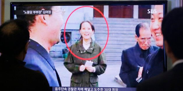 People watch a TV news program showing Kim Yo Jong, North Korean leader Kim Jong Un's younger sister,...