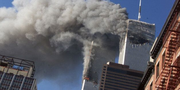 FILE - In this Sept. 11, 2001 file photo, smoke rising from the burning twin towers of the World Trade...