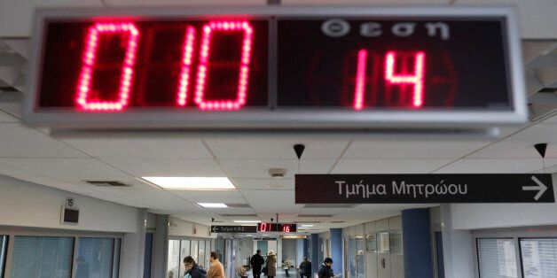 Greek taxpayers are seen inside Pallini's tax office in Pallini suburb, east of Athens February 15, 2013....