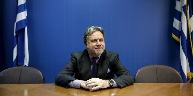 Greek Labour Minister George Katrougalos poses for a picture before an interview with Reuters at his...