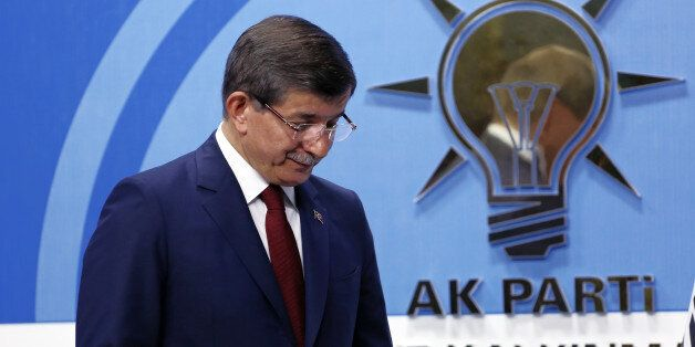 Turkish Prime Minister Ahmet Davutoglu leaves after a press conference at the headquarters of his ruling...