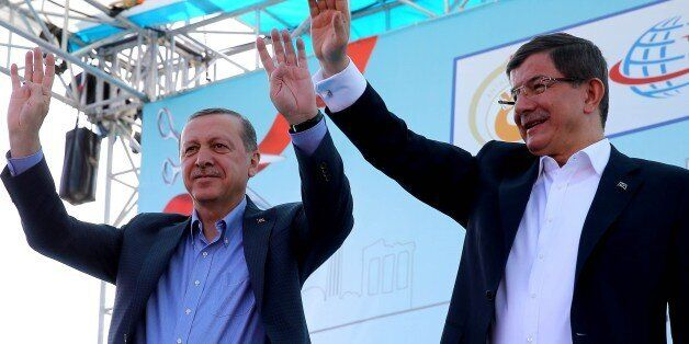 ANTALYA, TURKEY - APRIL 22: Turkish President Recep Tayyip Erdogan (L) raises his hands with the Rabia...