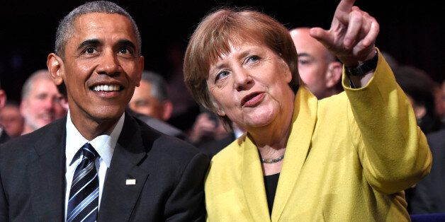 U.S. President Barack Obama, left, and German Chancellor Angela Merkel chat during the opening of the...