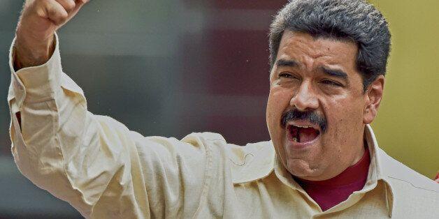 Venezuelan President Nicolas Maduro gestures during a rally in Caracas on April 19, 2016. Venezuelan...
