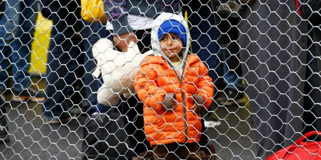 A migrant boy waits to cross the border from Slovenia into Spielfeld in Austria, February 16, 2016. REUTERS/Leonhard