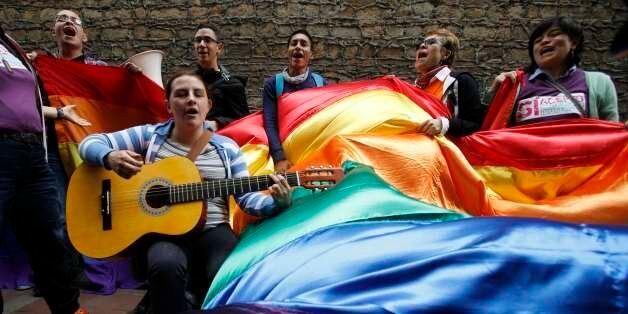 Activists sing as they wait outside a local court where Carlos Hernando and Gonzalo Ruiz were the first...