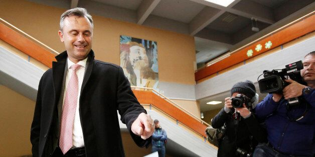 The candidat of the far-right Freedom Party (FPOe) Norbert Hofer drops his ballot at the polling station...