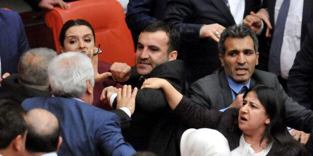 Turkish lawmakers pushe each other after a brawl erupted on the assembly floor, after a pro-Kurdish lawmaker...