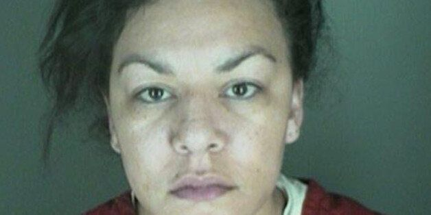 FILE - In this undated file photo, provided by the Longmont Police Department shows Dynel Lane, 34, who...