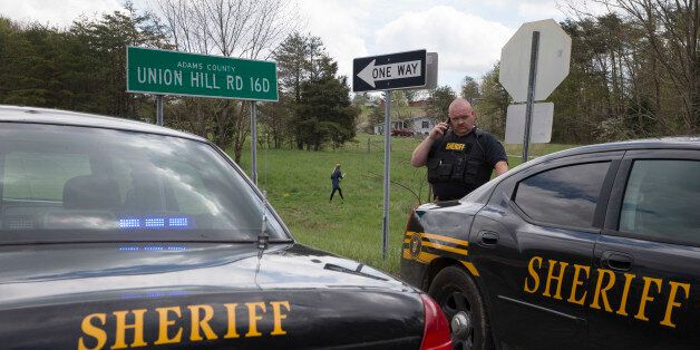 Authorities create a perimeter near a crime scene on Union Hill Rd, Friday, April 22, 2016, in Pike County,...