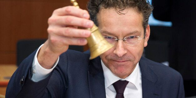 Eurogroup President and Dutch Finance Minister Jeroen Dijsselbloem rings the bell prior to a meeting...
