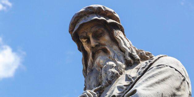 Milan, Milan Province, Lombardy, Italy. Statue in Piazza della Scala of artist Leonardo da Vinci, 1452-1519,...