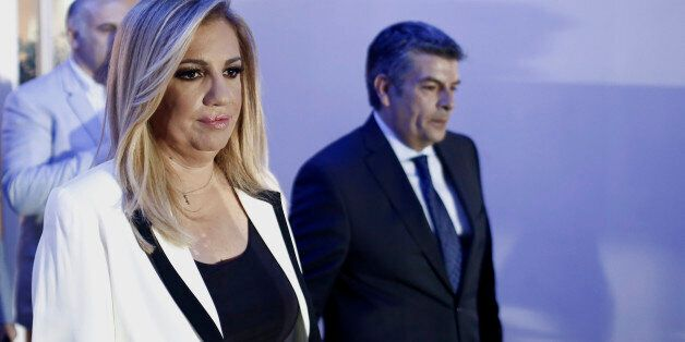 Fofi Gennimata, president of Pasok, also known as the Panhellenic Socialist Movement, left, leaves the...