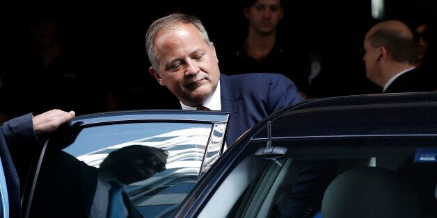 Benoit Coeure, executive board member of the European Central Bank (ECB) leaves a meeting with Greece's...