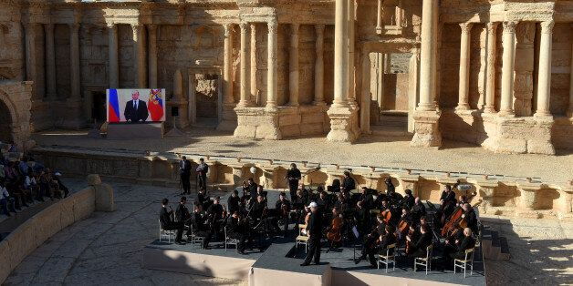 Russian conductor Valery Gergiev leads a concert in the amphitheatre of the ancient city of Palmyra on...