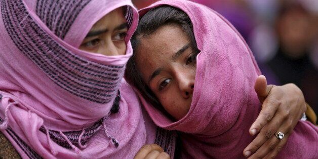 Kashmiri Muslim girls attend the funeral of Bilal Ahamd, a suspected militant, in Karimabad village in...