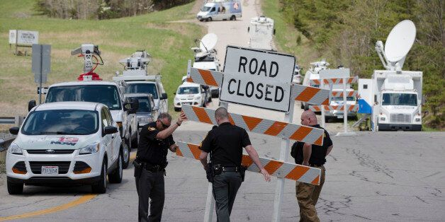 Authorities set up road blocks at the intersection of Union Hill Road and Route 32 at the perimeter of...