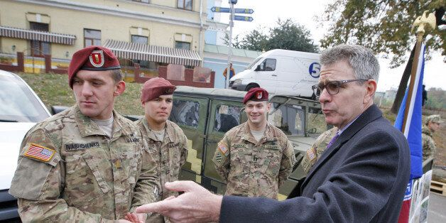 KIEV, UKRAINE - 2015/10/14: US Ambassador to Ukraine Geoffrey Pyatt (R) speaks with the American servicemen...