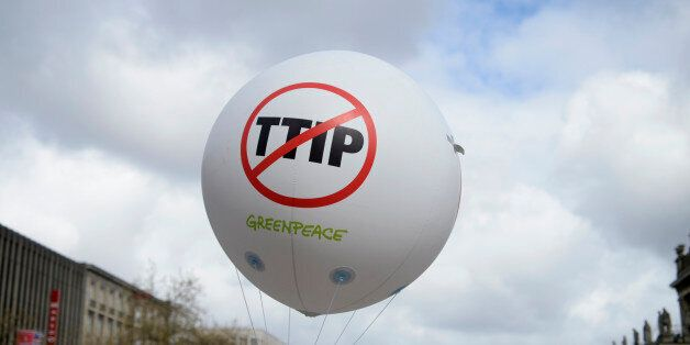A Greenpeace air ballon with a protest sign is pictured during a demonstration against Transatlantic...