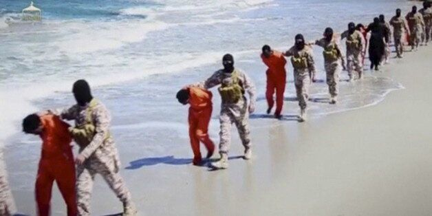 Islamic State militants lead what are said to be Ethiopian Christians along a beach in Wilayat Barqa,...