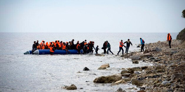 MYTELENE, GREECE - MARCH 09: Syrian refugees arrive on an inflatable boat with other refugee after crossing...