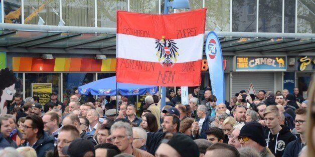 VIENNA, AUSTRIA APRIL 18 : Anti-refugee far right Freedom Party of Austria (FPO) and Pro-refugee 'Platform...