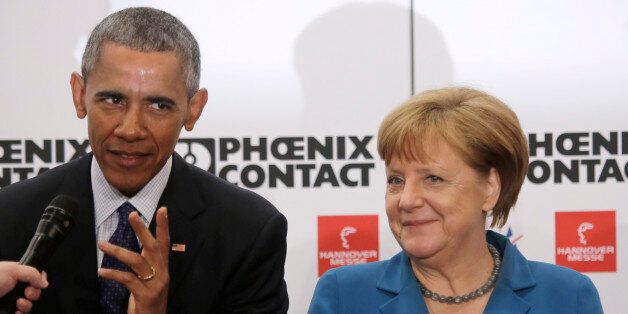 U.S. President Barack Obama and German Chancellor Angela Merkel, right, tour the Hannover Messe, the...