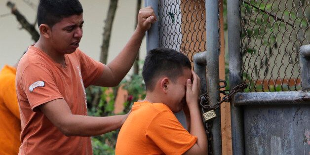 A boy cries as he finds out that their sister was killed in an earthquake in Pedernales, Ecuador, Sunday,...