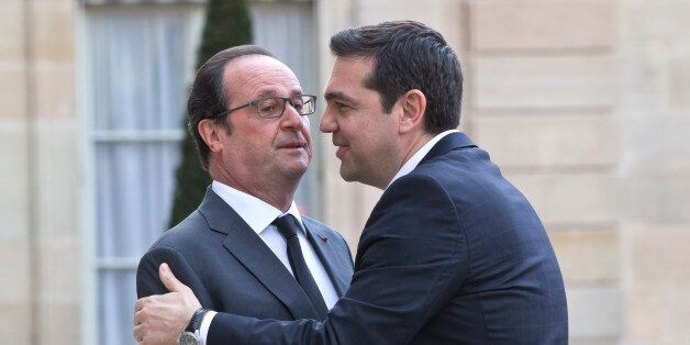 French President Francois Hollande, left, welcomes Greek Prime Minister Alexis Tsipras at the Elysee...