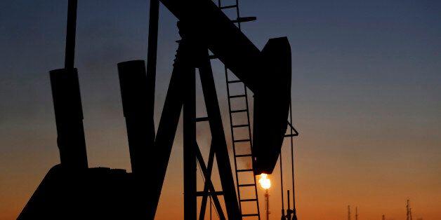 An oil pump works at sunset Monday, Jan. 18, 2016, in the desert oil fields of Sakhir, Bahrain. Iran...