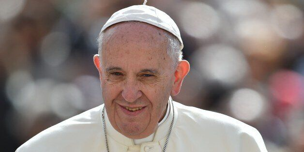 Pope Francis greets the crowd as he arrives for his weekly general audience at St Peter's square on April...