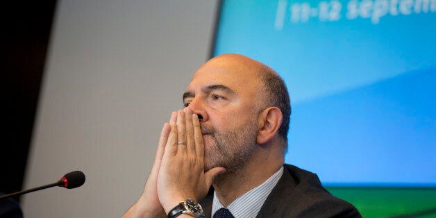European Commissioner for the Economy Pierre Moscovici pauses before speaking during a media conference...