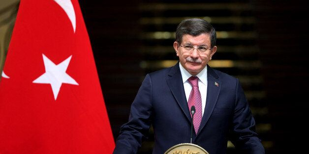 Turkish Prime Minister Ahmet Davutoglu speaks with media in a joint press conference with Iranian Vice-President...