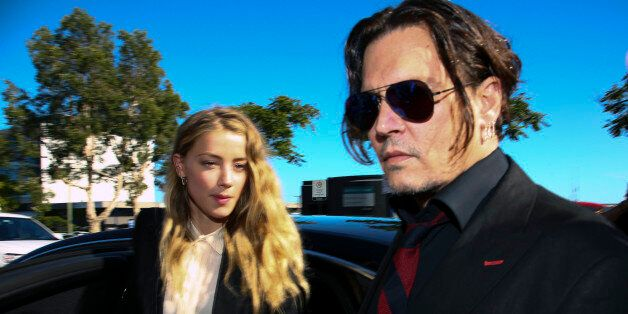 US actor Johnny Depp (R) and his wife Amber Heard arrive at a court in the Gold Coast on April 18, 2016....
