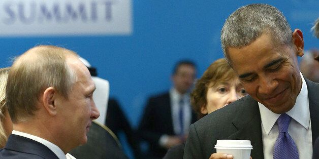 U.S. President Barack Obama (R) chats with Russia's President Vladimir Putin prior to a working session...