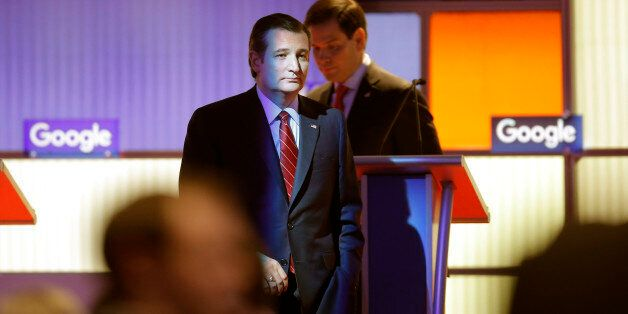 Republican U.S. presidential candidate Ted Cruz walks off the stage during a commercial break with rival...