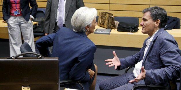 Greek Finance Minister Euclid Tsakalotos talks to International Monetary Fund (IMF) Managing Director...