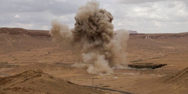 FILE - In this Thursday, April 14, 2016 photo, smoke rises from a controlled land mine detonation by...