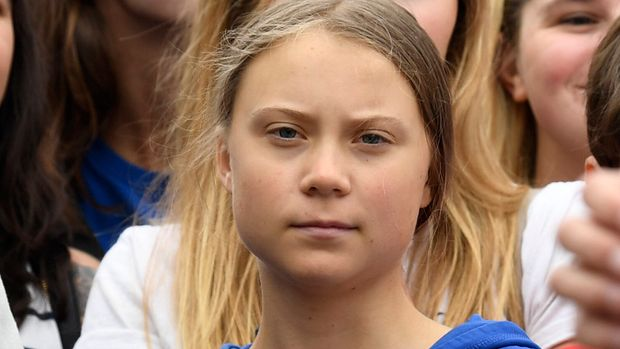 Swedish youth climate activist Greta Thunberg, center in blue, joins other young climate activists for a climate strike outside the White House in Washington, Friday, Sept. 13, 2019. (AP Photo/Susan Walsh)