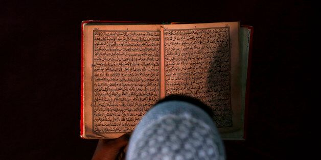 An Afghan boy reads the Koran in a madrasa, or religious school, during the Muslim holy month of Ramadan...