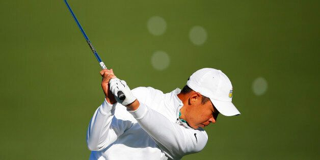 AUGUSTA, GEORGIA - APRIL 05: Cheng Jin of China hits on the practice range during a practice round prior...